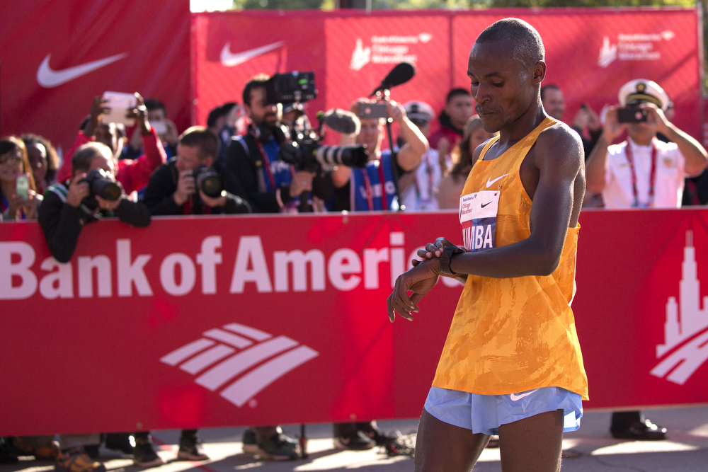 Men's elite winner Dickson Chumba of Kenya checks his watch after crossing the finish line at the Bank of America Chicago Marathon on Sunday, Oct. 11, 2015 in Chicago. (Erin Hooley/Chicago Tribune)