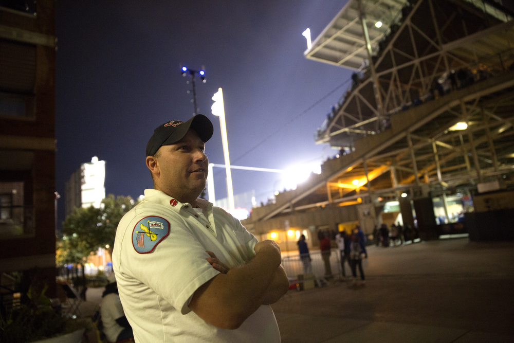 Lt. Daniel Reichenberger stands outside of the Wrigleyville firehouse, home of Engine Co. 78 and Ambulance Co. 6, across from Wrigley Field, during game 3 of the National League Championship Series between the Chicago Cubs and the New York Mets Tuesday, Oct. 20, 2015. (Erin Hooley/Chicago Tribune)