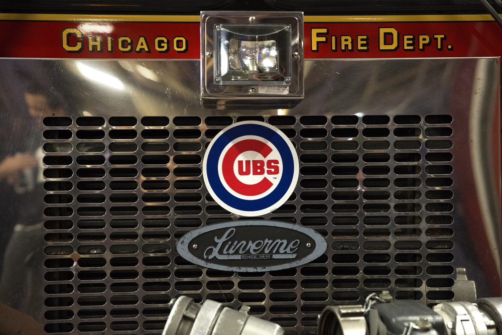 A Cubs logo adorns the fire engine at the Wrigleyville firehouse, home of Engine Co. 78 and Ambulance Co. 6, across from Wrigley Field, during game 3 of the National League Championship Series between the Chicago Cubs and the New York Mets Tuesday, Oct. 20, 2015. (Erin Hooley/Chicago Tribune)