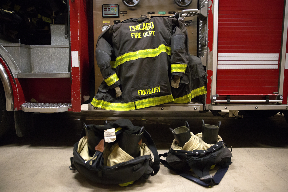 Firefighter Sam Fakhoury's gear is ready for a call at the Wrigleyville firehouse, home of Engine Co. 78 and Ambulance Co. 6, across from Wrigley Field, during game 3 of the National League Championship Series between the Chicago Cubs and the New York Mets Tuesday, Oct. 20, 2015. (Erin Hooley/Chicago Tribune)