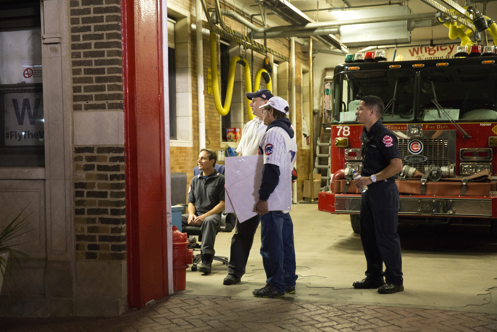 From left, Engineer Greg Piszkiewicz, Lt. Daniel Reichenberger, Paul Ashack and Firefighter Alan Negron watch game 3 of the National League Championship Series between the Chicago Cubs and the New York Mets  at the Wrigleyville firehouse, home of Engine Co. 78 and Ambulance Co. 6, across from Wrigley Field Tuesday, Oct. 20, 2015. (Erin Hooley/Chicago Tribune)