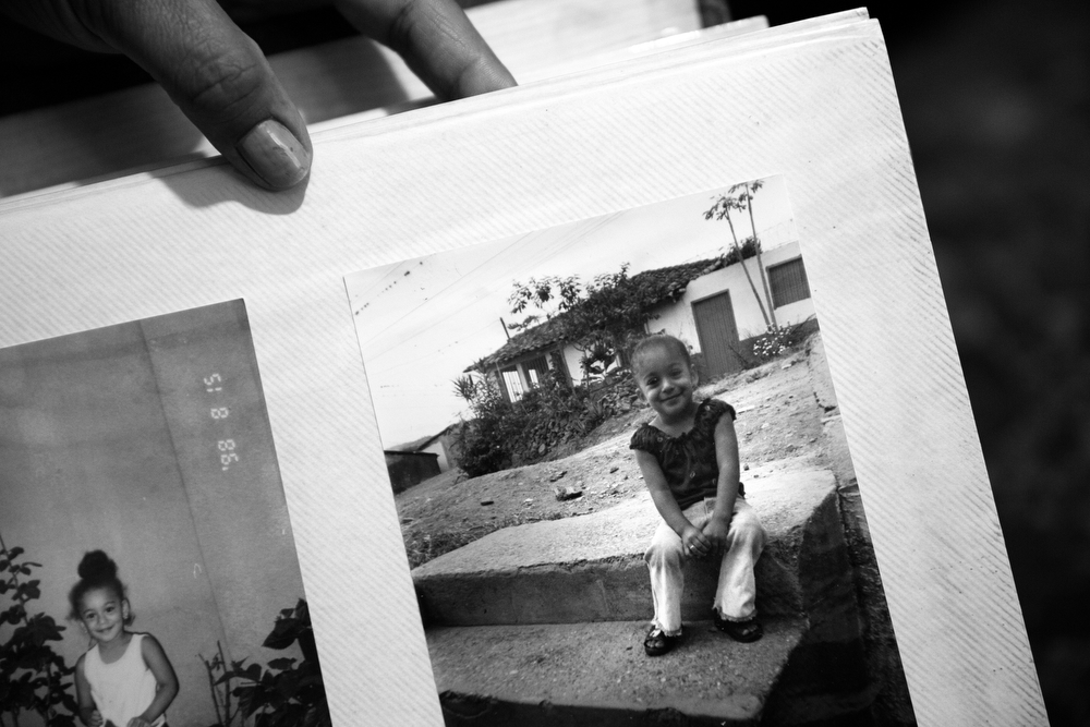 Maryori is pictured as a young child in her home country of Honduras in a photo album kept by her mother at their home in Waukegan. Tania left their home in Honduras when Maryori was just a baby to look for work in the United States. Maryori was raised by her father and eventually her aunt, but said she spoke to her mother on the telephone almost every day. As she grew older, gang violence in Honduras rose to an all-time high and Maryori was never allowed outside alone except for school. When she was 12, she was robbed at gunpoint on her way to classes. Not long after, she witnessed three young men shoot an older man in the head over a cellphone. (Erin Hooley/Chicago Tribune)