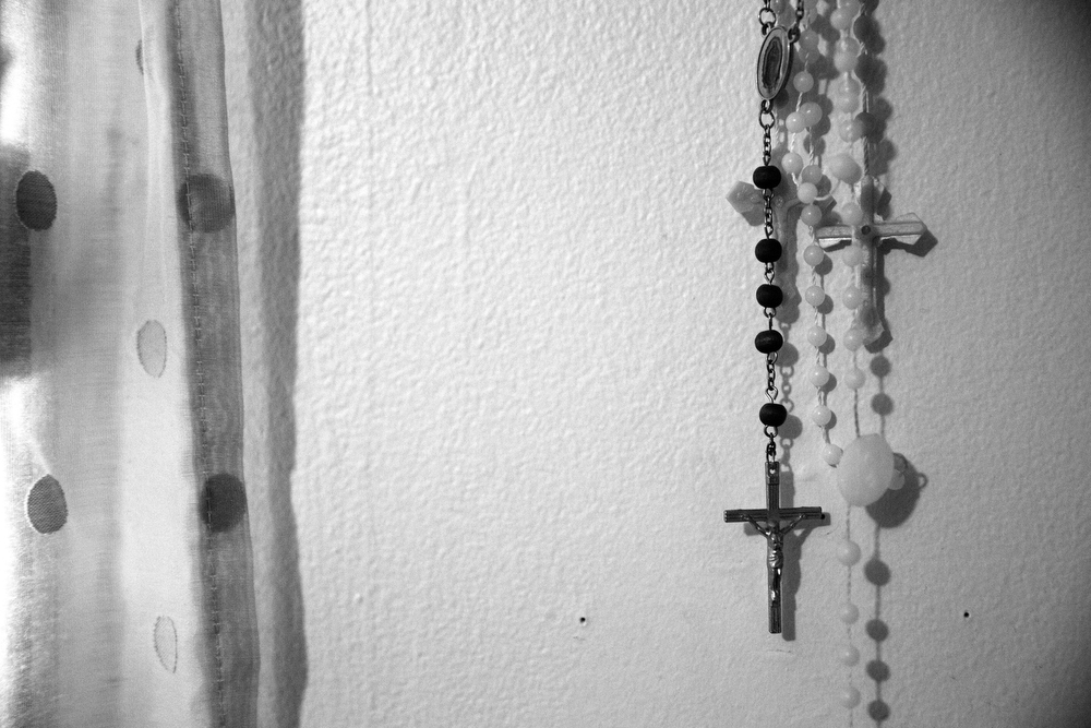 A rosary hangs on the wall of Maryori's bedroom Wednesday, Oct. 28, 2015 in Waukegan. Without telling her family in Honduras or her mother in the United States, Maryori made the decision to travel to the U.S. with a group of strangers and carried this rosary on her journey. She was merely one of 68,000 unaccompanied children who flooded across the southwest border of the United States, causing a humanitarian crisis in 2014. (Erin Hooley/Chicago Tribune)