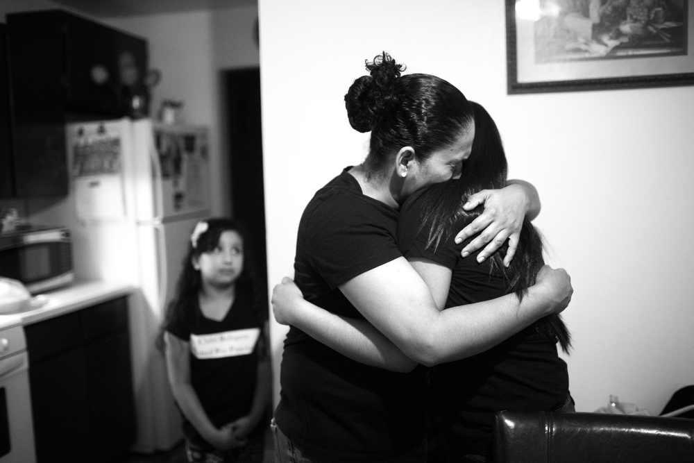With tears in her eyes, Tania hugs her daughter before they leave for Chicago. (Erin Hooley/Chicago Tribune)
