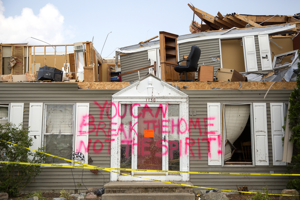 "A house in the Coalfield subdivision damaged by the June 22 tornadoes is spray painted with the words ""You can break the home not the spirit!"" Tuesday, June 30, 2015 in Coal City, Ill. (Erin Hooley/Chicago Tribune)"
