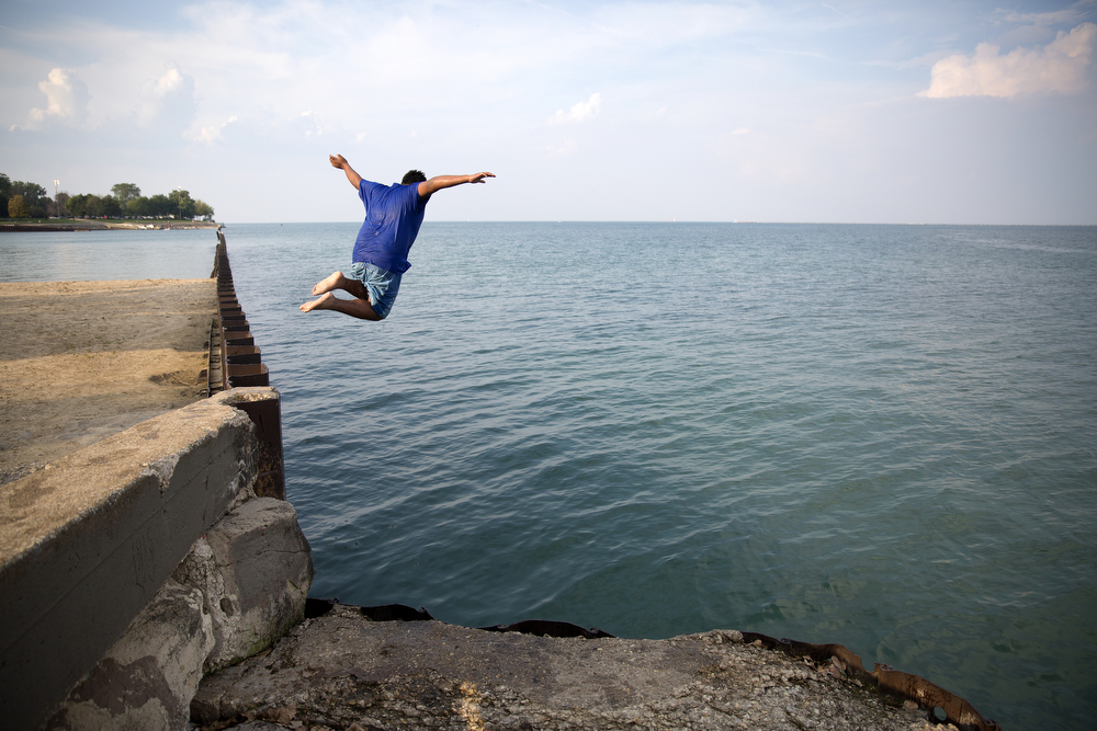Kevin Martinez, 15, jumps into Lake Michigan at Calumet Park Wednesday, Sept. 2, 2015 in Chicago. (Erin Hooley/Chicago Tribune)