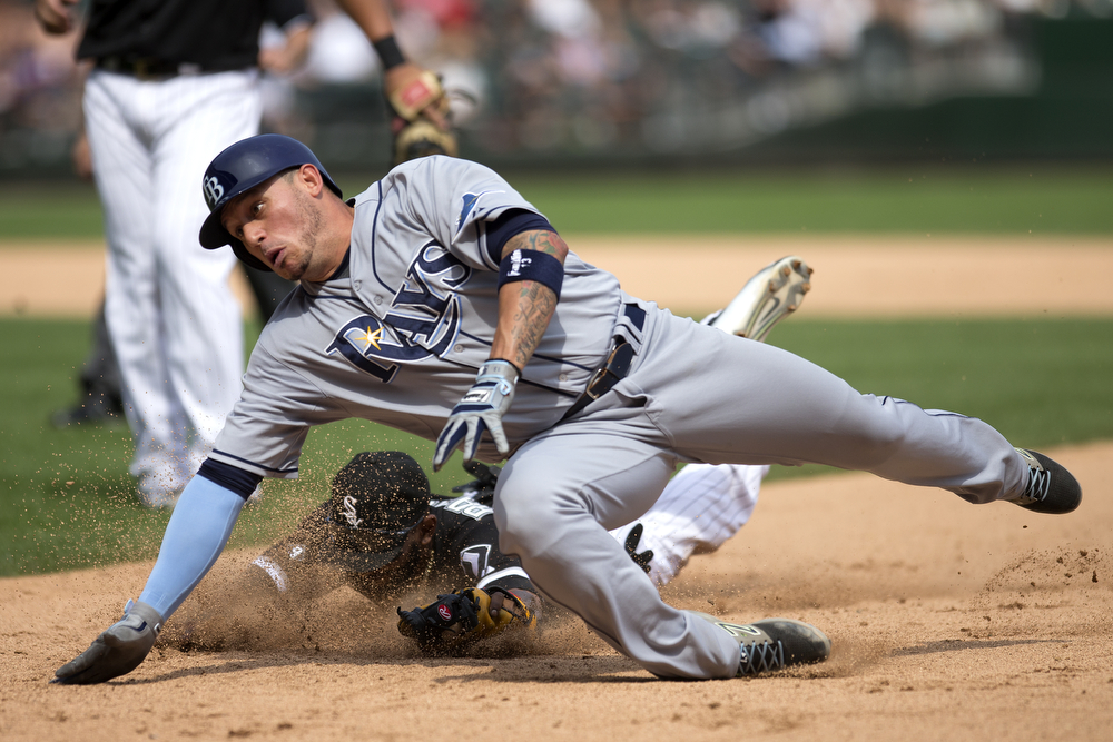 Tampa Bay Rays shortstop Asdrubal Cabrera dives for first base as Chicago White Sox shortstop Alexei Ramirez chases him down during the seventh inning of the Chicago White Sox versus the Tampa Bay Rays game at U.S. Cellular Field Wednesday, August 5, 2015 in Chicago. (Erin Hooley/Chicago Tribune)