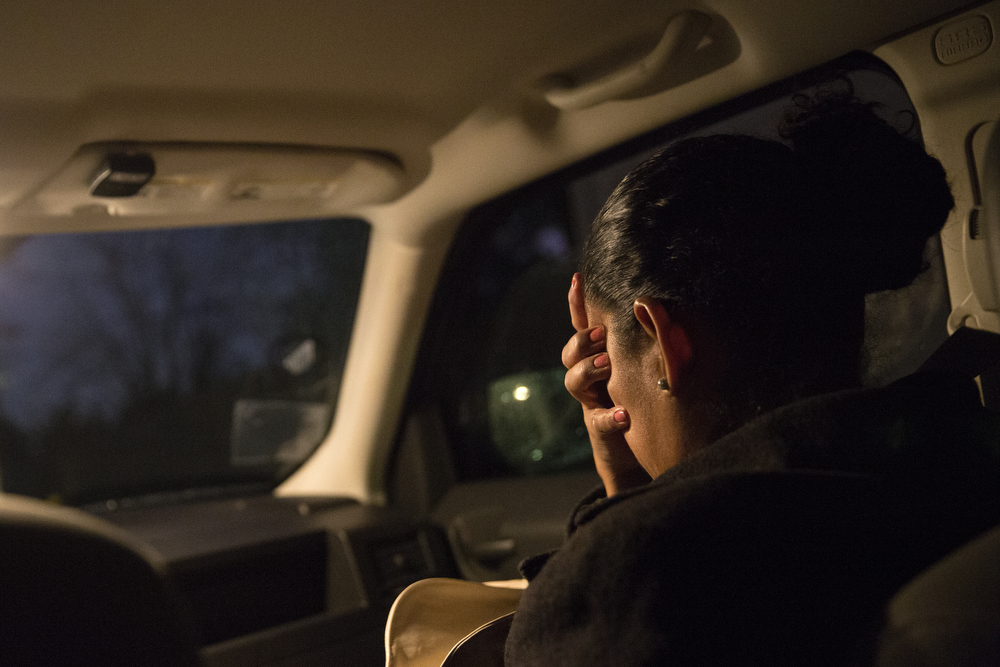 Tania Contreras Guerrero presses her hand into her face as she sits in the car of  Julie Contreras (no relation), a volunteer with the League of United Latin American Citizens of Lake County, in Waukegan, before driving with her to an immigration hearing at Chicago Immigration Court Wednesday, Oct. 28, 2015. Fleeing violence in her home country of Honduras, Tania's 15-year-old daughter Maryori Urbina Contreras travelled alone for several weeks in 2014 before reuniting with her mother, who has been in the United States since 2001. Her ongoing immigration case will eventually determine if she is allowed to stay in the U.S. or be forced to return to Honduras. Tania was worried her daughter might be deported. (Erin Hooley/Chicago Tribune)