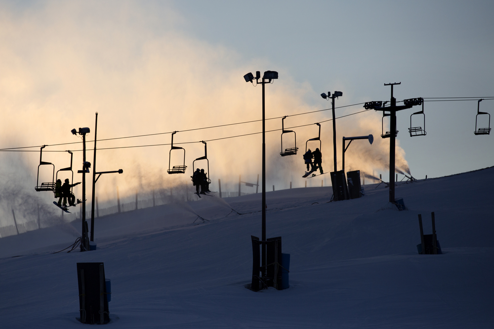 Skiers ride the lift as blowers create snow at Wilmot Mountain Ski Resort Wednesday, Jan. 20, 2016, in Wilmot, Wis. The Colorado-based company Vail Resorts recently purchased Wilmot. (Erin Hooley/Chicago Tribune)