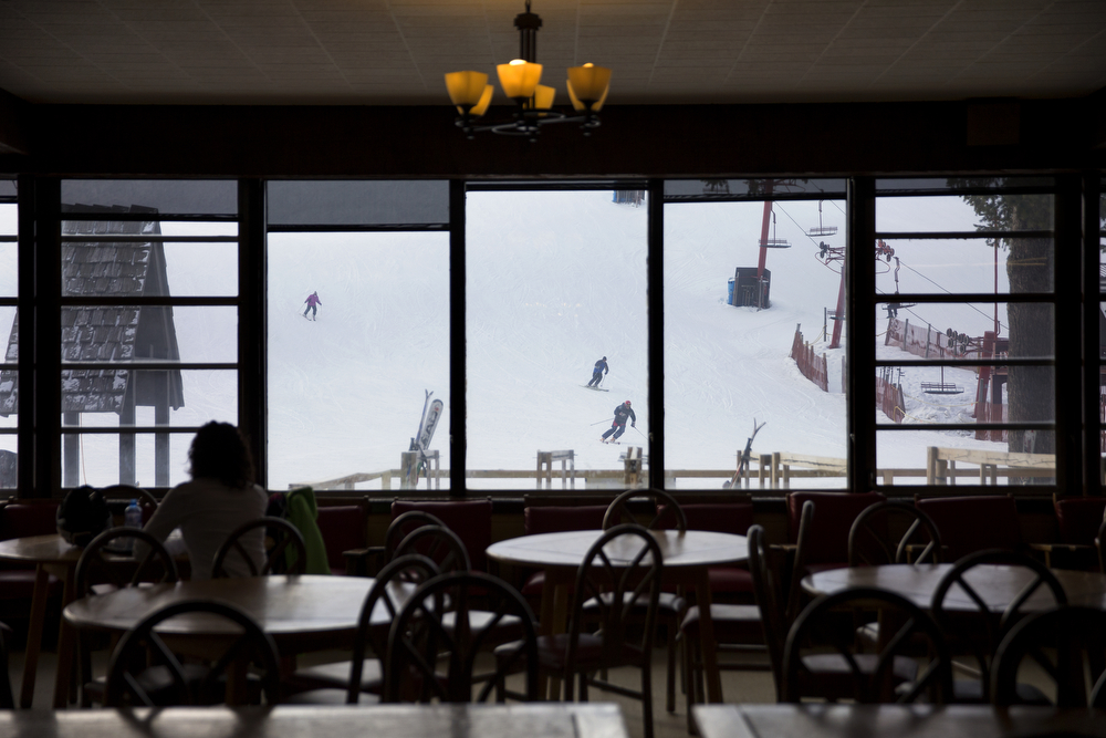 Skiers can be seen coming down the mountain from the dining area at Wilmot Mountain Ski Resort Wednesday, Jan. 20, 2016, in Wilmot, Wis. The Colorado-based company Vail Resorts recently purchased Wilmot. (Erin Hooley/Chicago Tribune)