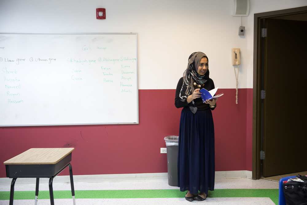 Saarah Bhaiji, 16, speaks to students as she fills in for a teacher in Islamic theology class at the Muslim Education Center Sunday, Jan. 31, 2016, in Morton Grove, Ill. Bhaiji teaches at the center on Sundays and attends Glenbrook South High School as a junior during the week, where she said her experience as a Muslim has been mostly positive. (Erin Hooley/Chicago Tribune)