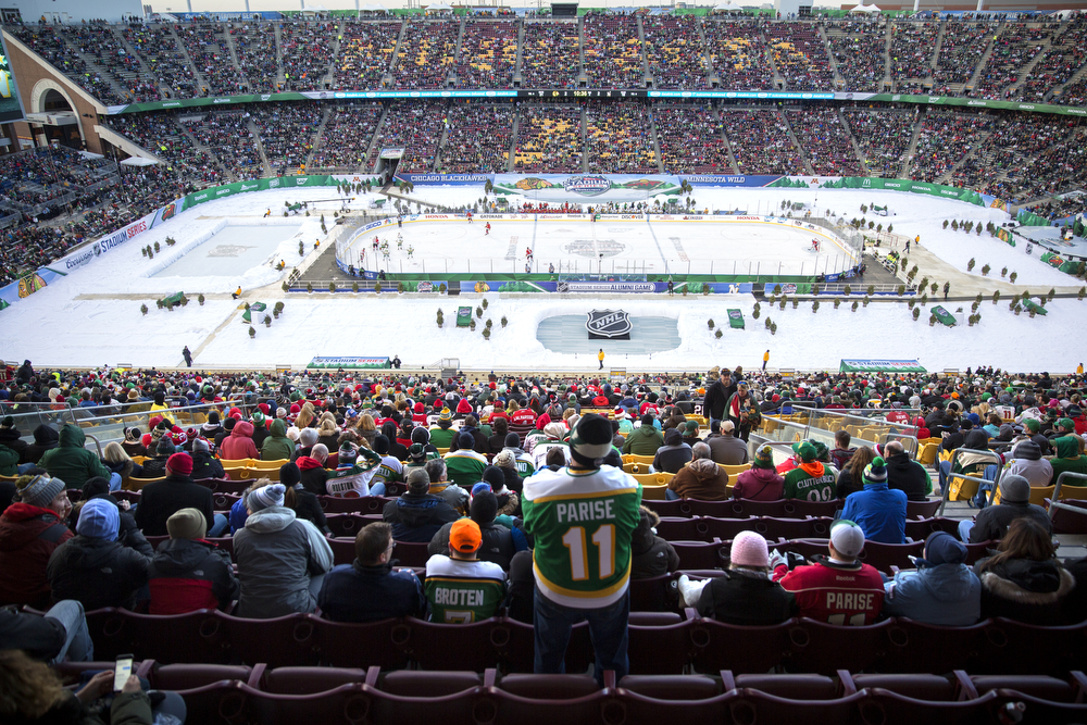 Fans watch the Chicago Blackhawks versus Minnesota Wild/Minnesota North Stars 2016 NHL Stadium Series Alumni Game at TCF Bank Stadium on the campus of the University of Minnesota Saturday, Feb. 20, 2016, in Minneapolis. Minnesota won the game 6-4. (Erin Hooley/Chicago Tribune)