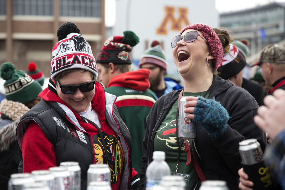 Nancy Perl, left, and Kristan Voss, both of Minnesota, although Perl is originally from Chicago, share beers with their friends before the Chicago Blackhawks versus Minnesota Wild 2016 NHL Stadium Series outdoor game at TCF Bank Stadium on the University of Minnesota Campus Sunday, Feb. 21, 2016, in Minneapolis. (Erin Hooley/Chicago Tribune)