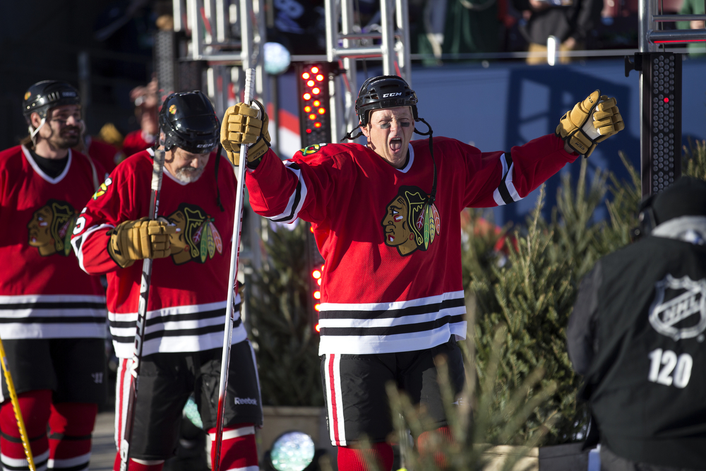 Chicago Blackhawks alumnus Jack O'Callahan walks out with his teammates for the Chicago Blackhawks versus Minnesota Wild/Minnesota North Stars 2016 NHL Stadium Series Alumni Game at TCF Bank Stadium on the campus of the University of Minnesota Saturday, Feb. 20, 2016, in Minneapolis. (Erin Hooley/Chicago Tribune)