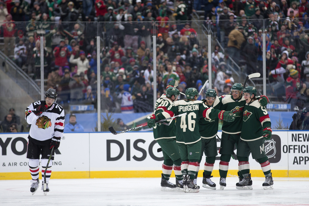 The Minnesota Wild celebrate another goal during the second period of the Chicago Blackhawks versus Minnesota Wild 2016 NHL Stadium Series outdoor game at TCF Bank Stadium on the University of Minnesota Campus Sunday, Feb. 21, 2016, in Minneapolis. The Wild beat the Blackhawks 6-1. The Wild beat the Blackhawks 6-1. (Erin Hooley/Chicago Tribune)