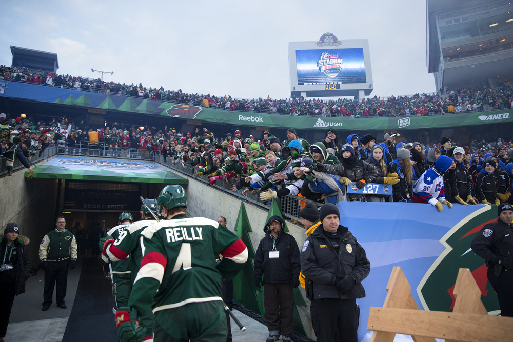 Fans reach out as the Minnesota Wild leave the ice after defeating the Chicago Blackhawks 6-1 in the 2016 NHL Stadium Series outdoor game at TCF Bank Stadium on the University of Minnesota Campus Sunday, Feb. 21, 2016, in Minneapolis. (Erin Hooley/Chicago Tribune)
