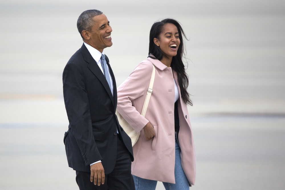 President Barack Obama walks to Air Force One with his daughter Malia at O'Hare International Airport Thursday, April 7, 2016, in Chicago. President Obama spoke at the University of Chicago, promoting his Supreme Court Nominee native Illinoisan Merrick Garland. (Erin Hooley/Chicago Tribune)
