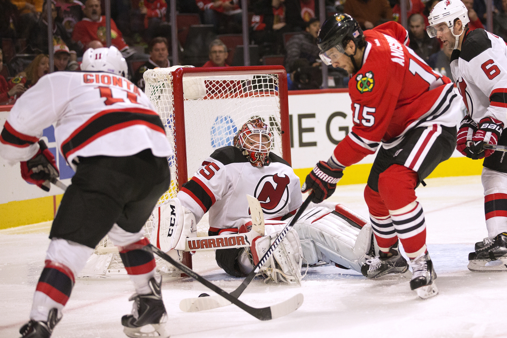 Chicago Blackhawks center Artem Anisimov (15), right, shoots toward New Jersey Devils defenseman New Jersey Devils goalie Cory Schneider (35) but the shot is blocked during the third period of the Chicago Blackhawks game against the New Jersey Devils at the United Center Thursday, Nov. 12, 2015 in Chicago. The Blackhawks lost 3-2. (Erin Hooley/Chicago Tribune)