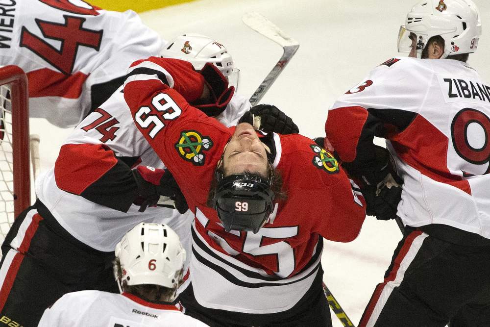 Chicago Blackhawks center Andrew Shaw (65) gets shoved in the face by Ottawa Senators defenseman Mark Borowiecki (74) during the first period of the Chicago Blackhawks versus the Ottawa Senators game at the United Center Sunday, Jan. 3, 2016 in Chicago. (Erin Hooley/Chicago Tribune)