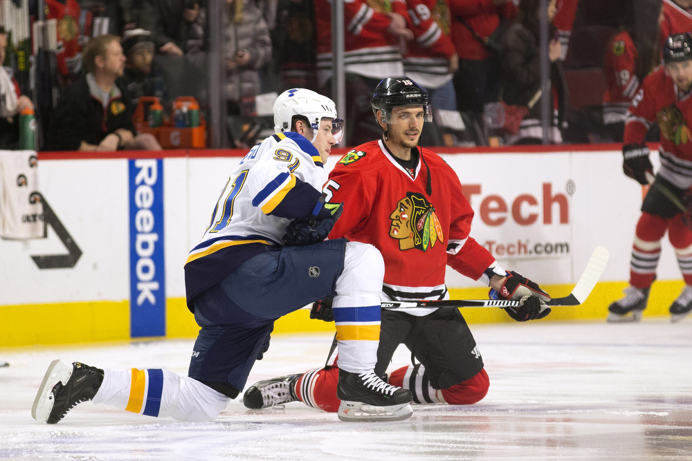 St. Louis Blues right wing Vladimir Tarasenko (91), left, and Chicago Blackhawks center Artem Anisimov (15), both Russian-born, chat before the Chicago Blackhawks versus St. Louis Blues game at the United Center Sunday, Jan. 24, 2016, in Chicago. (Erin Hooley/Chicago Tribune)