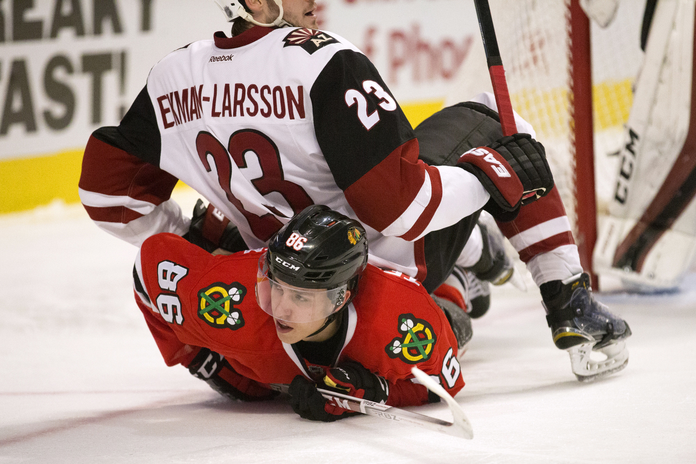 Arizona Coyotes defenseman Oliver Ekman-Larsson (23) falls on Chicago Blackhawks left wing Teuvo Teravainen (86) during the third period of the Chicago Blackhawks versus Arizona Coyotes Tuesday, April 5, 2016, at the United Center in Chicago. The Hawks defeated the Coyotes 6-2. (Erin Hooley/Chicago Tribune)