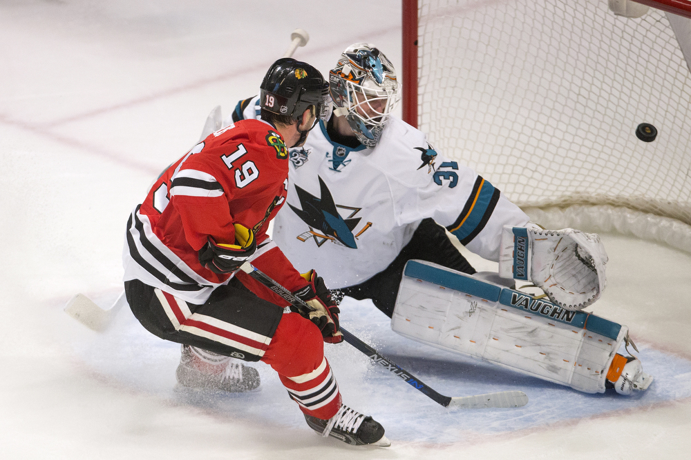 Chicago Blackhawks center Jonathan Toews (19) gets the puck past San Jose Sharks goalie Martin Jones (31) to score the game-winning goal in overtime during the Chicago Blackhawks versus San Jose Sharks game at the United Center Sunday, Dec. 20, 2015 in Chicago. The final score was 4-3. (Erin Hooley/Chicago Tribune)