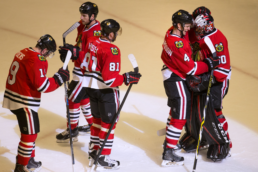 Chicago Blackhawks defenseman Niklas Hjalmarsson (4) hugs Chicago Blackhawks goalie Corey Crawford (50) after he shut out the St. Louis Blues 2-0 at the United Center Sunday, Jan. 24, 2016, in Chicago. (Erin Hooley/Chicago Tribune)