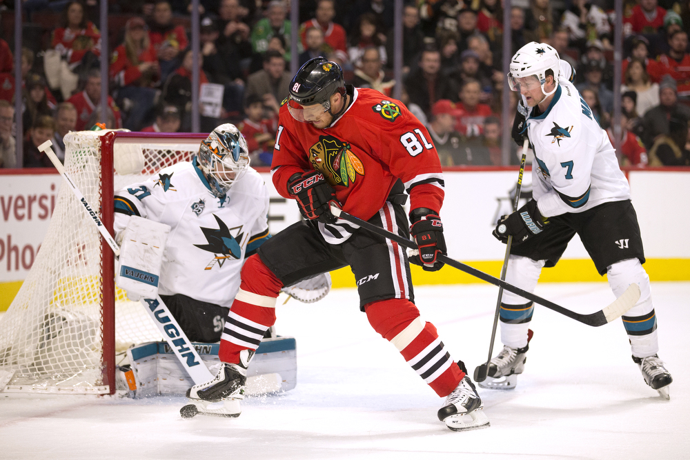 Chicago Blackhawks right wing Marian Hossa (81) tries to get control of the puck with his skate during the third period of the Chicago Blackhawks versus the San Jose Sharks game at the United Center Tuesday, Feb. 9, 2016, in Chicago. The Blackhawks fell to the Sharks 2-0. (Erin Hooley/Chicago Tribune)
