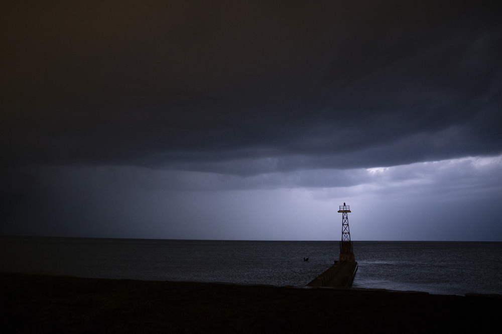 Lightning illuminates storm clouds over Lake Michigan near Foster Beach Monday, April 25, 2016, in Chicago. The National Weather Service issued a severe thunderstorm watch in north central and north eastern Illinois valid until 10 p.m. Minutes later, lightning and downpour swept across much of Chicago. (Erin Hooley/Chicago Tribune)