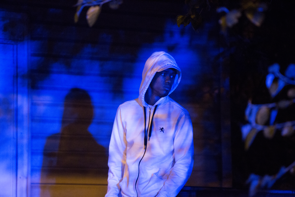 A young man is illuminated by lights from police vehicles as he stands on a porch near the scene of a fatal shooting in the 6400 block of South Damen Avenue Thursday, June 23, 2016, in the West Englewood neighborhood of Chicago. A 28-year-old man was shot in the head and killed at the scene and another 38-year-old man shot in the leg was taken Advocate Christ Medical Center. (Erin Hooley/Chicago Tribune)