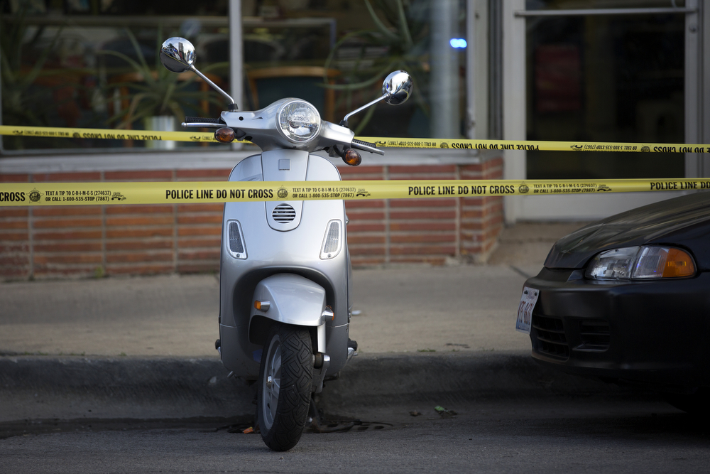 A Vespa scooter is surrounded by police tape near the scene of a fatal shooting in the 2900 block of West Armitage Avenue in Logan Square Friday, June 3, 2016, in Chicago. A 20-year-old man was shot and pronounced dead at the scene and a 21-year-old man was shot in the right leg and was taken to Advocate Illinois Masonic Hospital. (Erin Hooley/Chicago Tribune)