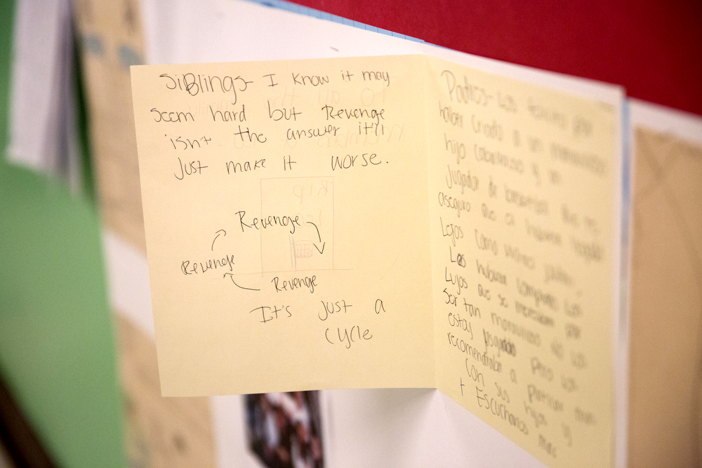 A letter written by a schoolmate of 13-year-old Leonardo Betancourt, who was shot and killed in the Back of the Yards neighborhood on Monday evening, is posted with other letters and photos in a hallway at William H. Seward Communication Arts Academy Elementary School Wednesday, May 4, 2016, in Chicago. Family members of Leonardo visited the school Wednesday. (Erin Hooley/Chicago Tribune)