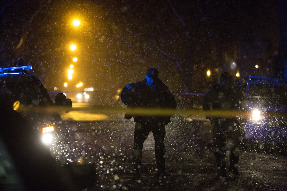 Heavy snow falls as members of the Chicago Police Department work the scene of a shooting in the 7200 block of South Sangamon Street Wednesday, Feb. 24, 2016, in the Englewood neighborhood of Chicago. A 72-year-old woman was shot in the chest, arm and leg and was taken to Advocate Christ Medical Center. (Erin Hooley/Chicago Tribune)