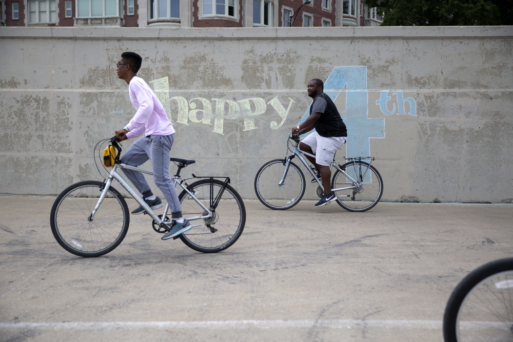 Bicyclists pass a chalk mural along the Lakefront Trail near Navy Pier Monday, July 4, 2016, in Chicago. (Erin Hooley/Chicago Tribune)