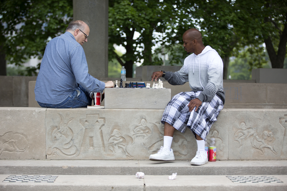 Bill Brock, left, and Al Harrison play chess near North Avenue Beach Monday, July 4, 2016, in Chicago. (Erin Hooley/Chicago Tribune)