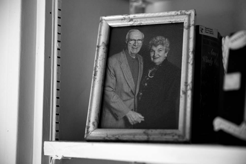 "A photo of now 92-year-old Margaret Coleman and her husband, John Coleman, who she called ""Jack,"" sits on a shelf near her bedside at the Coleman family home Sunday, July 24, 2016, in Chicago. Margaret and her husband John Coleman had 14 children together. (Erin Hooley/Chicago Tribune)"