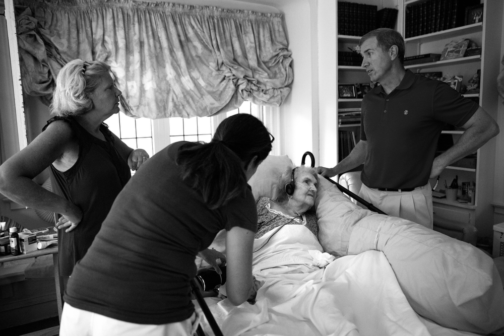 From left, Peggy Cahill, Cathleen Loch and Dan Coleman, three of 92-year-old Margaret Coleman's 14 children, talk to her during a visit at the Coleman family home Sunday, July 24, 2016, in Chicago. Although she is on oxygen and can no longer walk, Margaret remains in high spirits and wishes to stay in the family house, so her children organize and take turns caring for her during the week. She also receives frequent visits from many of her 48 grandchildren and 13 great-grandchildren. (Erin Hooley/Chicago Tribune)