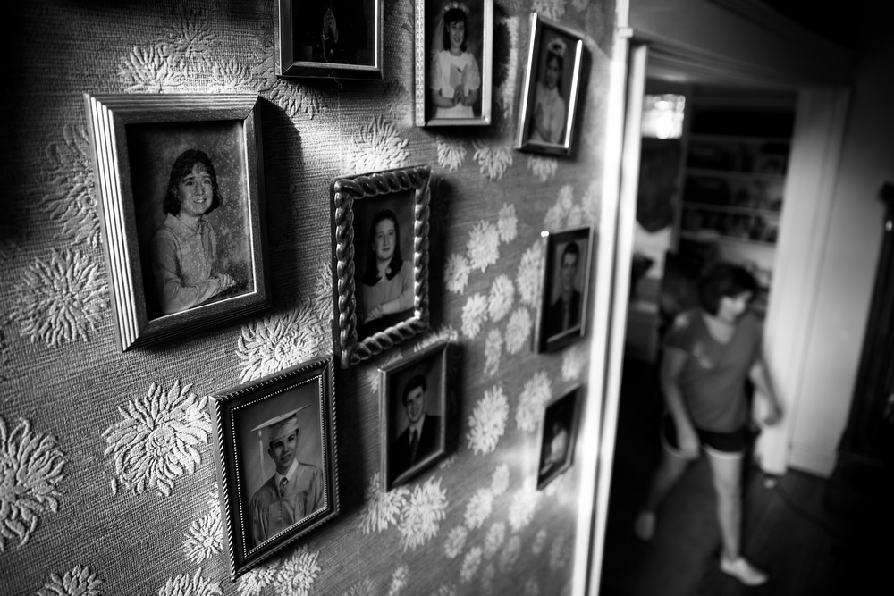 Photos of some of 92-year-old Margaret Coleman's 48 grandchildren hang on the wall of the Coleman family home Monday, July 25, 2016, in Chicago. Margaret and her husband John Coleman had 14 children together. (Erin Hooley/Chicago Tribune)