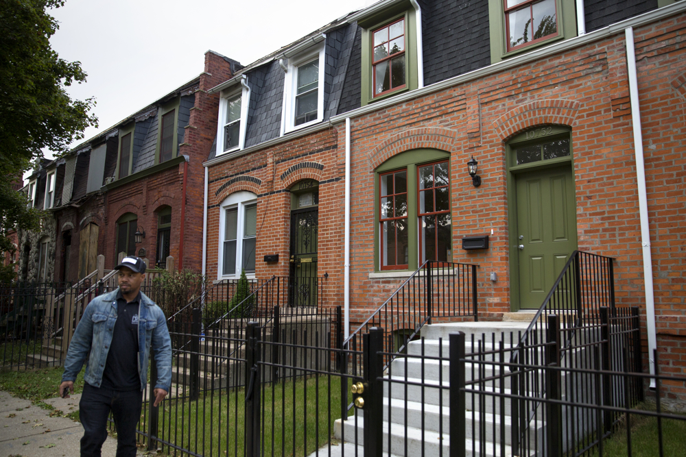 Renovated houses are finished Wednesday, Oct. 12, 2016, in the Pullman neighborhood of Chicago. About 28 young men are participating in a pilot program launched by the Emerson Collective meant to help them learn job skills and find future employment while participating community renewal in many Chicago neighborhoods. (Erin Hooley/Chicago Tribune)