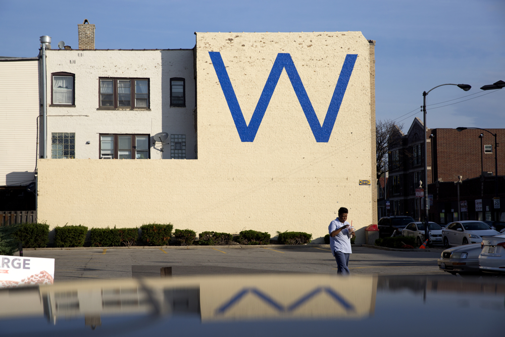 "A large blue ""W"" is painted on the side of a building in the 3800 block of North Kedzie Avenue Tuesday, Nov. 1, 2016, in the Irving Park neighborhood of Chicago. The Chicago Cubs play the Cleveland Indians in game 6 of the World Series tonight. (Erin Hooley/Chicago Tribune)"