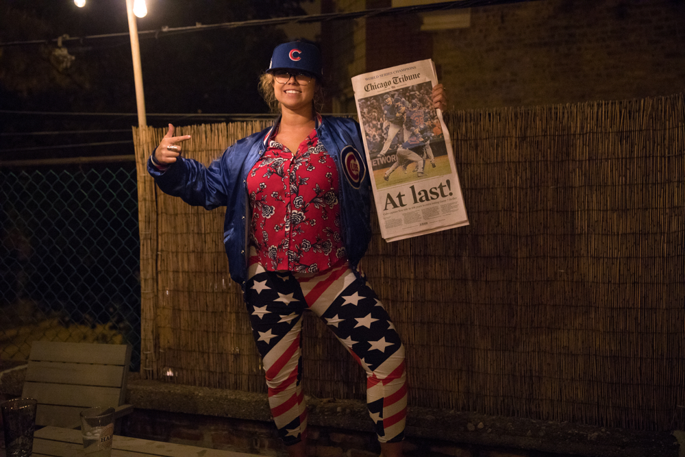 Nicole Budde holds a copy of the Chicago Tribune as she celebrates the Chicago Cubs' historic World Series win over the Cleveland Indians Thursday, Nov. 3, in Wrigleyville in Chicago. (Erin Hooley/Chicago Tribune)