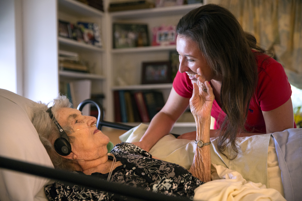 "Kerry Morris, 24, one of 92-year-old Margaret Coleman's 48 grandchildren, visits with her at the Coleman family home Monday, July 25, 2016, in Chicago. Although she is on oxygen and can no longer walk, Margaret remains in high spirits and wishes to stay in the family house, so her children organize and take turns caring for her during the week. Marge's children, John, Mike, Tom, Tim, Maureen, Maribeth, Peggy, Terry, Patty, Rich, David, Diane, Cathleen and Dan, kept a schedule and took turns caring for their mother in 12-hour shifts in the house where they all grew up. Although she was a nurse and her husband Jack a doctor at Mercy Hospital in Chicago, Marge was not too keen on seeing doctors herself. The family was happy to help.""They gave a lot to us and really built a strong family bond and so they instilled that in us, that you have to take care of each other,"" said Maureen Kelly, child number five. Margaret ""Marge"" Coleman passed away on Sunday, August 7, surrounded by her family at home.  (Erin Hooley/Chicago Tribune)"