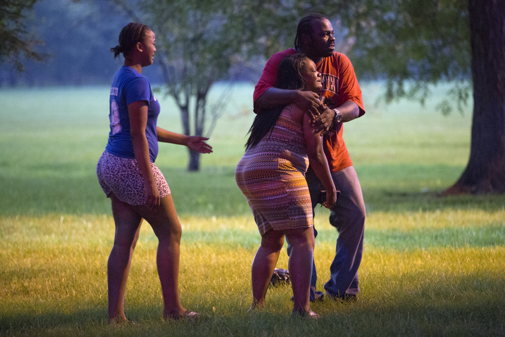 "A man clings to a woman near the body of a gunshot victim laying in the grass at the scene of a fatal double shooting in Ogden Park Monday, Labor Day, Sept. 5, 2016, in the Englewood neighborhood of Chicago. The 47-year-old man was walking his dog in the crowded park as people celebrated the holiday when shots were fired from a vehicle and he was struck in the chest. He likely died at the scene.  A man clings to a woman near the body of a gunshot victim laying in the grass at the scene of a fatal double shooting in Ogden Park Monday, Labor Day, Sept. 5, 2016, in the Englewood neighborhood of Chicago. The 47-year-old man was walking his dog in the crowded park as people celebrated the holiday when shots were fired from a vehicle and he was struck in the chest. He likely died at the scene. Lacoah Curtis packed up food and picnic supplies as the sun set over the park and police nearby told people the park was closed. Curtis grew up here but hasn't been to a barbecue in a park in 10 or so years because she fears shootings. When she was in high school, she said, someone who wanted to kill someone else went and found that person, and shot them. But now, ""people don't care about shooting into a crowded park"" and hitting innocent bystanders. (Erin Hooley/Chicago   Tribune)   p.p1 {margin: 0.0px 0.0px 0.0px 0.0px; font: 12.0px Helvetica}"