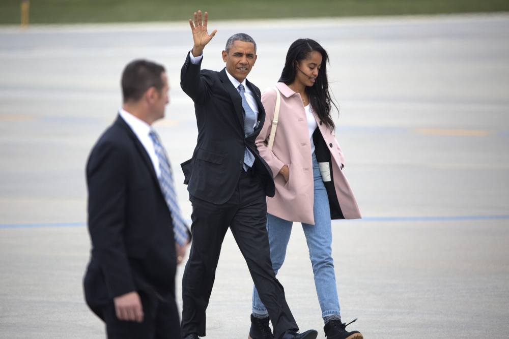 President Barack Obama waves as he walks to Air Force One with his daughter Malia at O'Hare International Airport Thursday, April 7, 2016, in Chicago. President Obama spoke at the University of Chicago, promoting his Supreme Court Nominee native Illinoisan Merrick Garland. (Erin Hooley/Chicago Tribune)