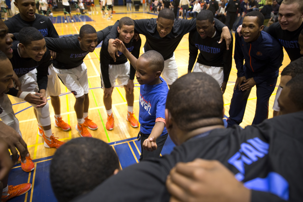 Javion Irvy, 8, does a dance in the huddle of Evanston Township High School players before the 4A sectional semifinal game against Notre Dame College Prep at Glenbrook South High School Tuesday, March 8, 2016, in Glenview, Ill. Notre Dame beat Evanston 68-56. (Erin Hooley/Chicago Tribune)
