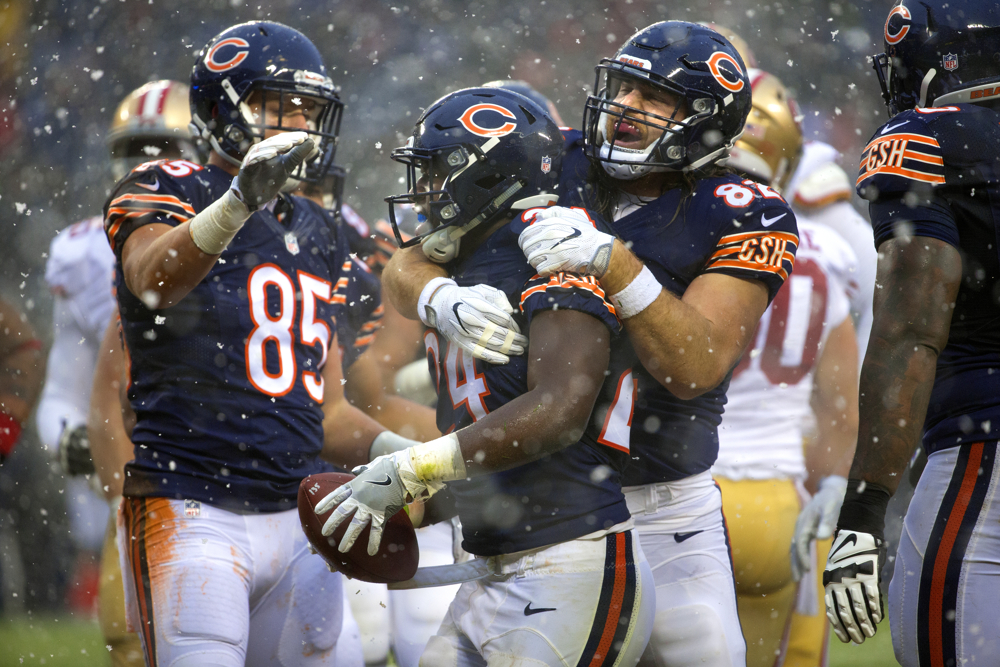 Chicago Bears tight end Logan Paulsen (82) grabs Chicago Bears running back Jordan Howard (24) after he scored a touchdown during the first half of the Chicago Bears versus San Francisco 49ers game Sunday, Dec. 4, 2016, at Soldier Field in Chicago. (Erin Hooley/Chicago Tribune)