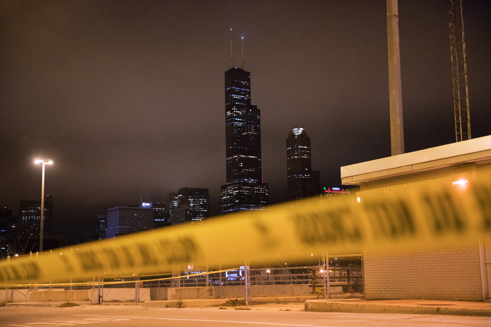 Willis Tower can be seen beyond police tape at the scene of a shooting in the 1200 block of South Union Avenue Friday, Dec. 9, 2016, in the University Village neighborhood of Chicago. A 17-year-old male was in the back seat of a vehicle when he was shot in the chest. The driver fled and ended up in the 1800 block of South Calumet Avenue. (Erin Hooley/Chicago Tribune)