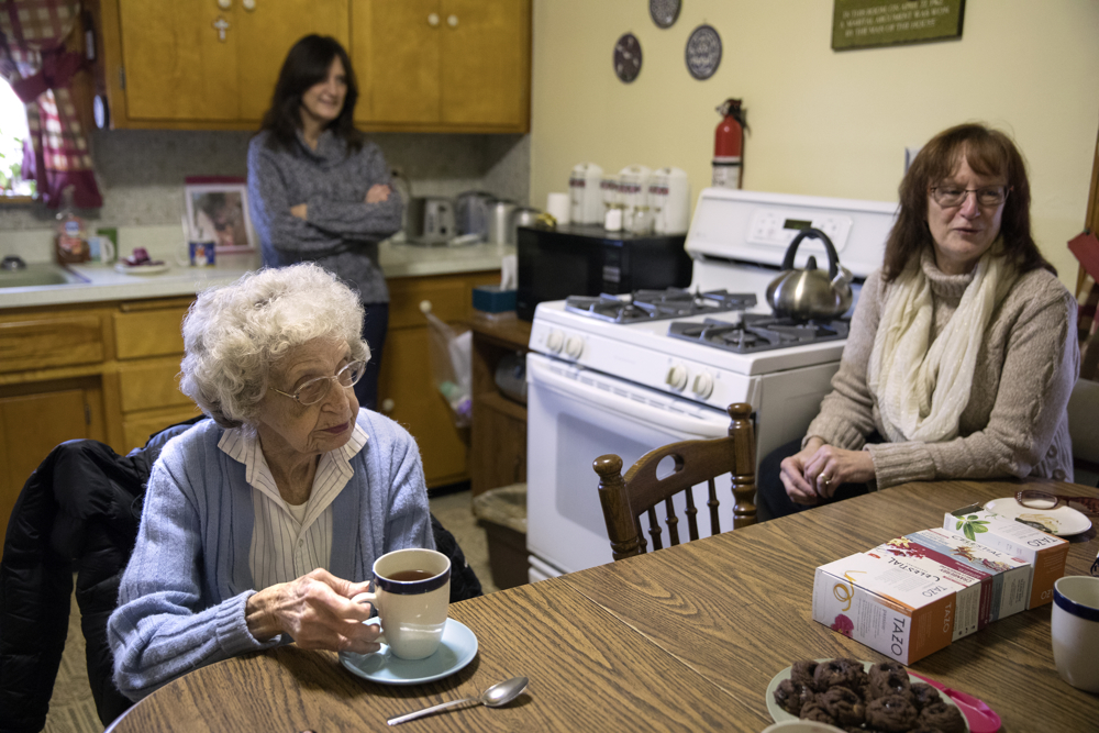 94-year-old World War II Navy veteran Josephine Regnier has tea with her family at her home Monday, Jan. 2, 2017, in the Garfield Ridge neighborhood of Chicago. Regnier was outside her Southwest Side home in the 5100 block of South Long Avenue waiting for her daughter when she was attacked after she went in to escape the cold on December 7. A large man hit her several times, bruising her face and breaking several ribs, before fleeing the scene with her purse. (Erin Hooley/Chicago Tribune)