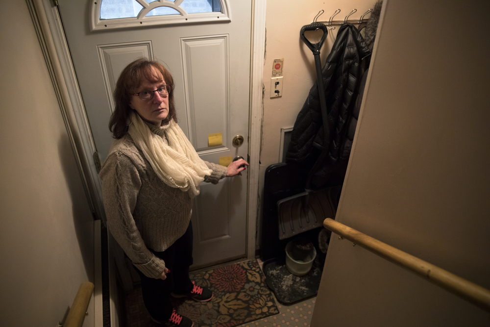 Joan O'Connor, daughter of 94-year-old World War II Navy veteran Josephine Regnier, stands in the vestibule where her mother was attacked in her home Monday, Jan. 2, 2017, in the Garfield Ridge neighborhood of Chicago. Regnier was outside her Southwest Side home in the 5100 block of South Long Avenue waiting for her daughter when she was attacked after she went in to escape the cold on December 7. A large man hit her several times, bruising her face and breaking several ribs, before fleeing the scene with her purse. (Erin Hooley/Chicago Tribune)