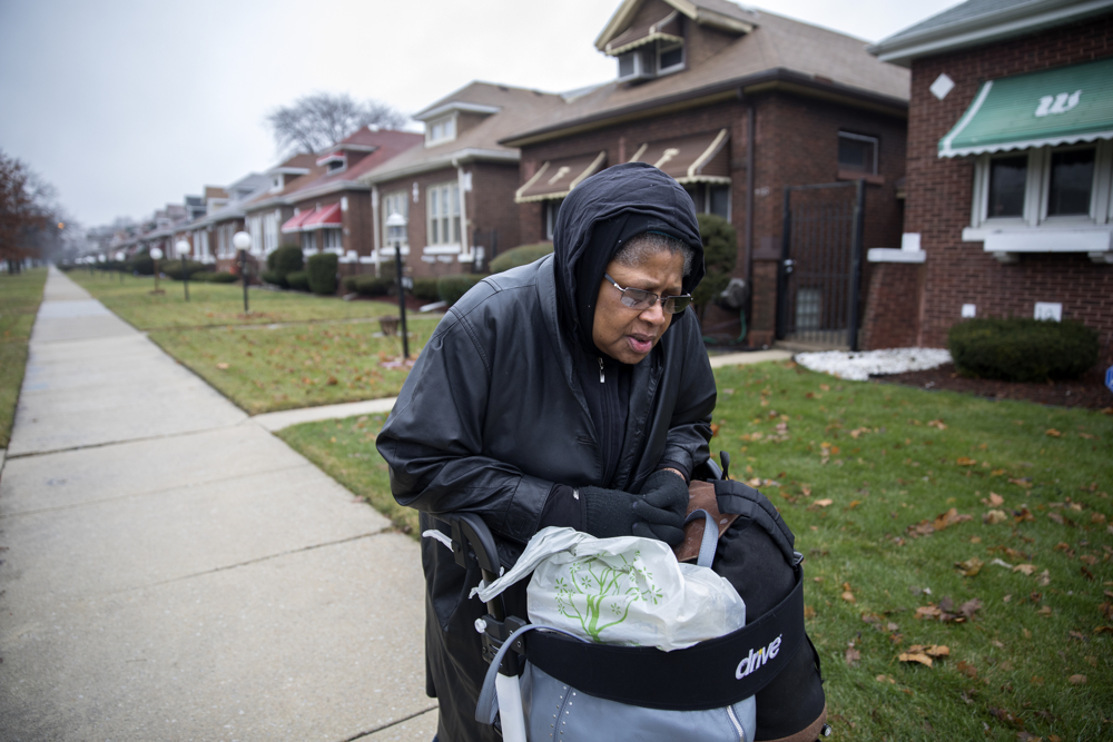 "71-year-old Kathyé Dawoudi makes her way from her home to the bus stop in the 7600 block of South State Street Tuesday, Jan. 3, 2017, in the Chatham neighborhood of Chicago. Dawoudi's 23-year-old grandson was shot and killed at his apartment building in 2015 about two blocks from the stop. ""I'm not going to let violence dictate me. For myself or any of my children,"" she said. (Erin Hooley/Chicago Tribune)"